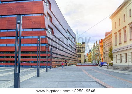 Wroclaw/Poland- August 19, 2017: Cityscape of Wroclaw with colorful historical houses and part view of postmodern building of the National Forum of Music at Liberty Square.
