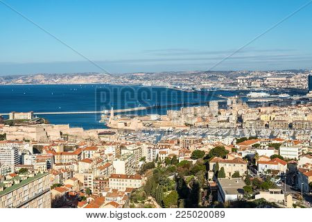 Marseille, France - December 4, 2016: Aerial panoramic view of Marseille from basilica of Notre Dame de la Garde for Saint Jean Castle and the old Vieux port in Marseille, Provence, France. Cruise port in the background.