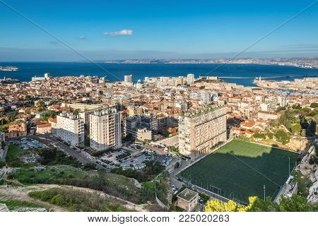 Marseille, France - December 4, 2016: Aerial panoramic view of Marseille from basilica of Notre Dame de la Garde in Marseille, Provence, France. Soccer field in the foreground.