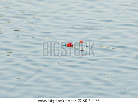 Fishing float floating in the water . Photo of an abstract texture