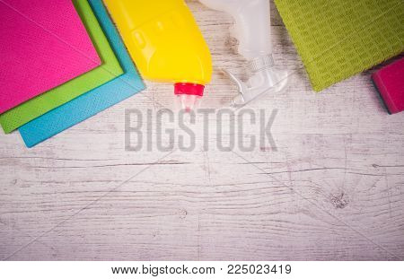 Set Of Cleaning Up Stuff On Wooden Background.