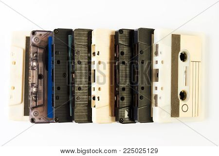 Vintage audio cassette tape. ollection of retro cassette tapes isolated on a white background, close-up. Tape and audio, music and sound, media and record