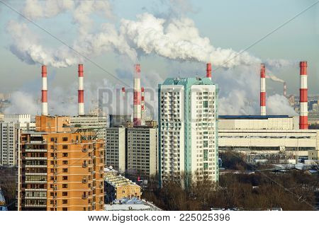 Panoramic view of the Akademichesky district in winter with the smoking chimneys of the combined heat and power plant 20. Moscow, Russia
