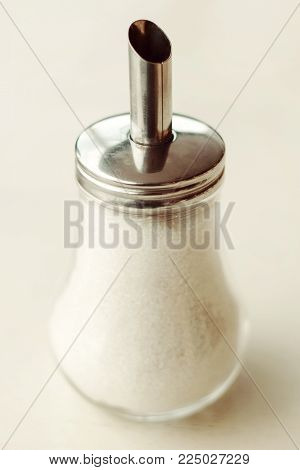 Transparent sugar bowl from granulated sugars in cafe