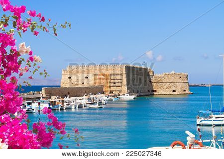 Heraklion harbour with old venetian fort, Crete, Greece with flowers