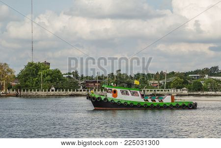Tug Boat Pull Large Cargo Ship In River