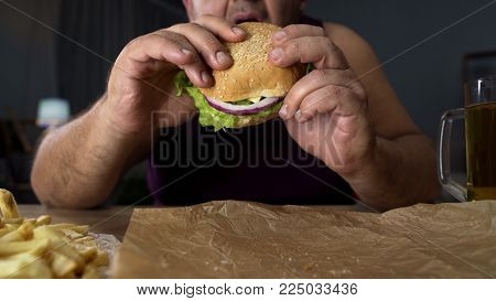 Obese person biting big burger, addicted to unhealthy junk food, overeating, stock footage