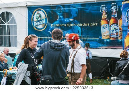 Prague, September 23, 2017: Celebrating the traditional German beer festival called Oktoberfest in the Czech Republic. Friends met and talked about different things.