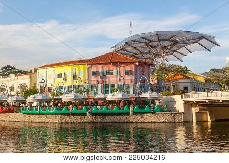 CLARKE QUAY, SINGAPORE - AUGUST 17, 2009: Colorful restaurants at Clarke Quay overlooking the Singapore River.