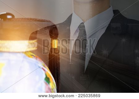 Businessman with Graduate study abroad concept, Graduation cap on top Earth globe model map. Graduate study abroad program and Back to School and Studies lead to success in world wide.