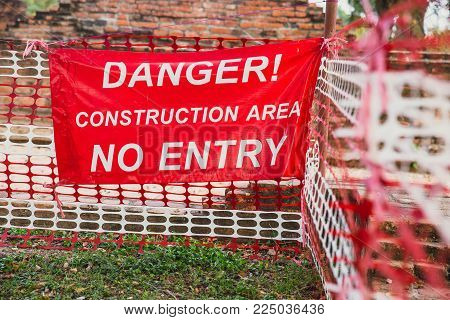 Danger Construction Area No Entry warning banner in under construction site