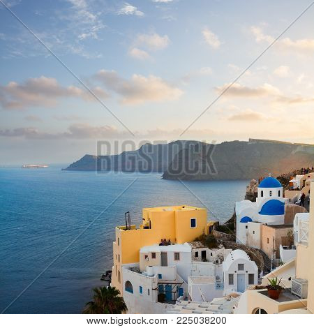 lanscape of Oia with blue church domes, volcano caldera and Aegan sea, beautiful details of Santorini island, Greece