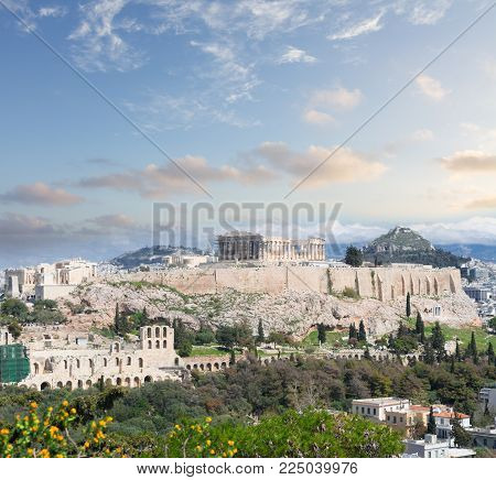 Famous skyline of Athens with Acropolis hill at sunset, Pathenon, Herodes Atticus amphitheater and Lycabettus Hill, Athens Greece