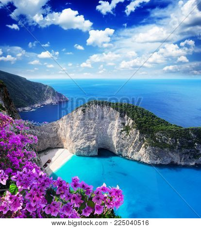 Navagio beach, famous lanscape of Zakinthos island, Greece with flowers