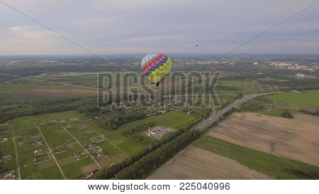 Hot air balloon in the sky over a field in the countryside. Aerostat fly in the countryside.