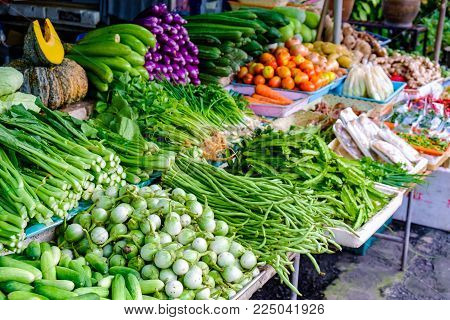 Asian farmer's market selling fresh green salat vegetables