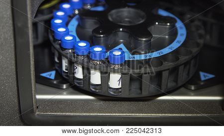 Medical centrifuge for mixing in the laboratory. Tubes prepared in lab centrifuge machine . Modern technologies in medical equipment