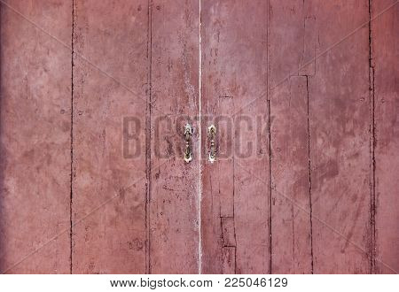 The old vintage retro door made of hardwood. Large brown wooden door with vintage door handle made of old steel. with copy space for your text.