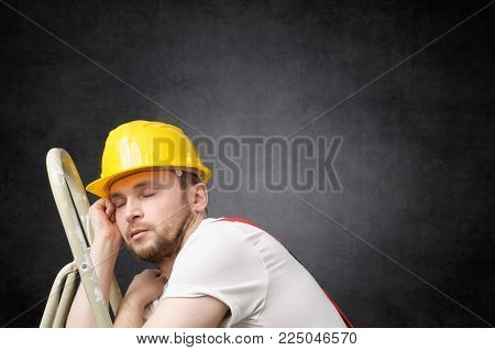 Lazy construction worker sleeping on a ladder