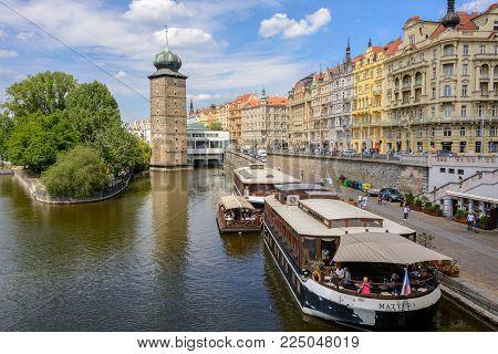 Prague, Bohemia, Czech Republic - June 6, 2017: Prague main sights - Embankment of the Vltava River and Sitkovska water tower, Prague, Czech Republic