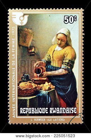 RWANDA - CIRCA 1975 : Cancelled postage stamp printed by Rwanda, that shows painting by Vermeer.
