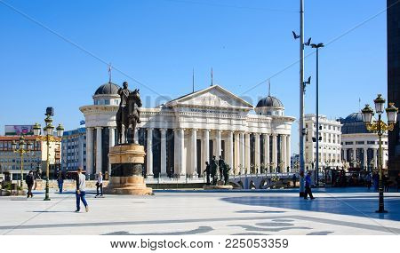 SKOPJE, MACEDONIA - OCTOBER 12, 2017: Macedonia square in Skopje city with Archeological museum and monuments on a sunny day
