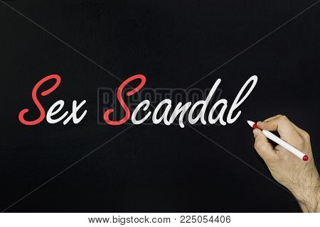 chalk drawing concept 2018. Person's hand drawing with chalk on blackboard. pinay sex scandal