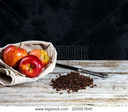 Recipe With Cloves And Apple On An Old Wooden White Table. Non Uniform Dark Background With Free Spa