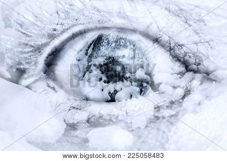 Conceptual,Winter Christmas rural Scene, with snow covered woodland manipulated into a human eye