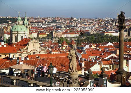 PRAGUE, CZECH REPUBLIC - AUGUST 24, 2016: People walking and look around from St Vitus cathedral and panoramic view Prague Skyline, in Prague, Czech Republic