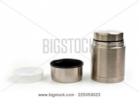 Lightweight, metallic thermos for eating with a plastic plate on a white background