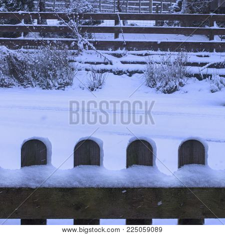 Winter Christmas rural Scene, with snow covered Picket fence