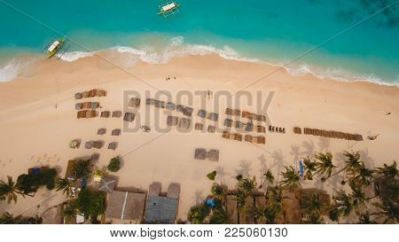 Aerial view of beautiful tropical island with with azure water, Boracay. Tropical lagoon with turquoise water. Beautiful tropical beach on the island. Seascape: Beautiful view of the rock in the sea from the air. Philippines Travel concept.