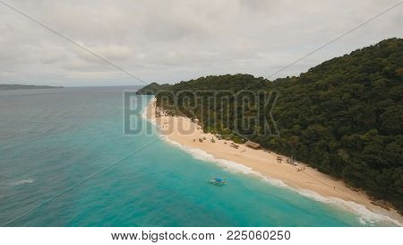 Aerial view of beautiful tropical island with white sand beach, hotels and tourists, Boracay, Puka shell beach. Tropical lagoon with turquoise water and white sand. Beautiful sea, beach, resort. Beautiful tropical beach of Boracay island. Seascape: Ocean
