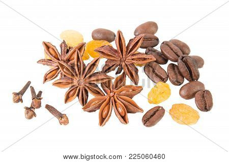 Anise star with cloves, coffee beans and raisins on white background top view