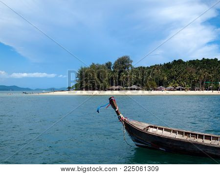 Beautiful beach with Tai long boat on the front