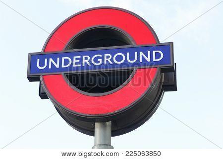 London, United Kingdom - February 1, 2018: Underground sign in London. The London Underground is a public rapid transit system serving London