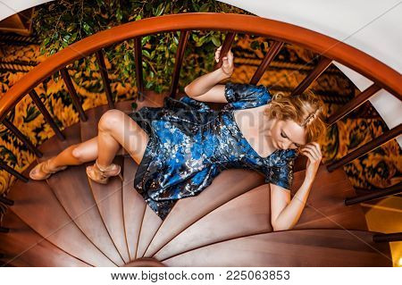 Beautiful Fashion Wooman Posing On Steps Of Staircase