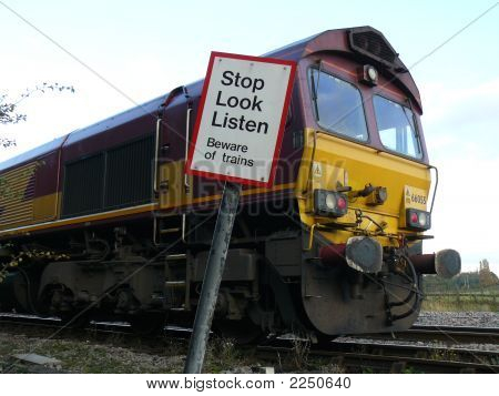 Freight Train Engine With Warning Sign
