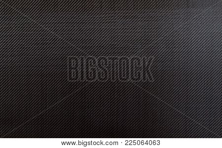 5.7 oz. 3k plain weave carbon fiber cloth background