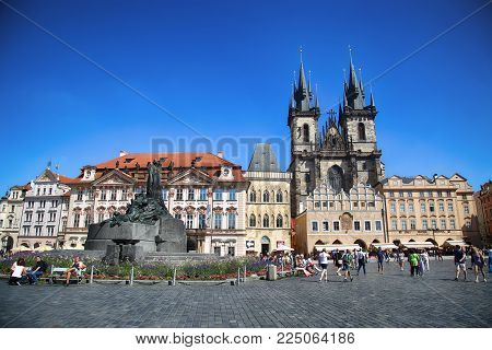 PRAGUE, CZECH REPUBLIC - AUGUST 24, 2016: People walking and look around Old Town Square and Church of our Lady Tyn in Prague, Czech Republic
