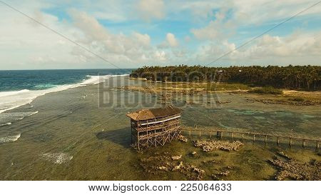 Viewpoint in the ocean at Cloud Nine surf point, Siargao island , Philippines. Aerial view raised wooden walkway for surfers to cross the reef of siargao island to cloud 9 surf break mindanao. Siargao islands famous surf break cloud 9.