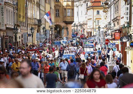 PRAGUE, CZECH REPUBLIC - AUGUST 23, 2016: Many people walking and look around Mostecka street in Old Town Square in Prague, Czech Republic