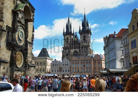 PRAGUE, CZECH REPUBLIC - AUGUST 23, 2016: People walking and look around Astronomical clock Orloj at Old Town Square in Prague, Czech Republic