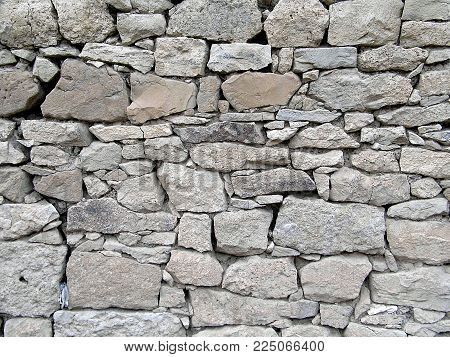 stone wall, very old stone wall paintings, ruined old wall, decor can be used as stone wall paintings,