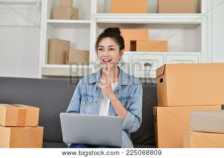 Sme business concept. Young Owner are packing their packages. Delivery business Small and Medium Enterprise(SMEs). Young Owner Start up for Business Online. Young are thinking about the business.