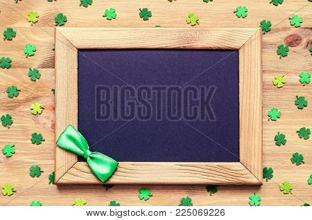 St Patricks Day Background. Wooden Frame With Green Bow Tie And Free Space For Text And Green Quatre
