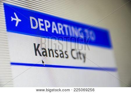 Computer screen close-up of status of flight departing to Kansas City, Missouri, USA