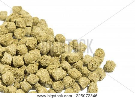 Rabbit feed pellets on a white background