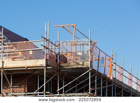 Construction of residential property surrounded by scaffolding